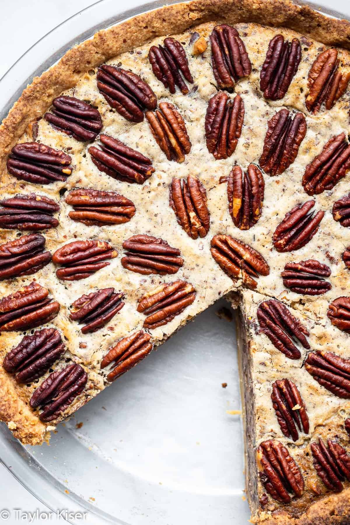 Keto pecan pie with a slice taken out