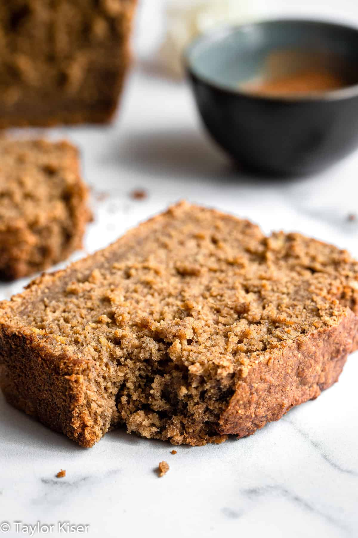 vegan gluten free banana bread with a bite out of a slice