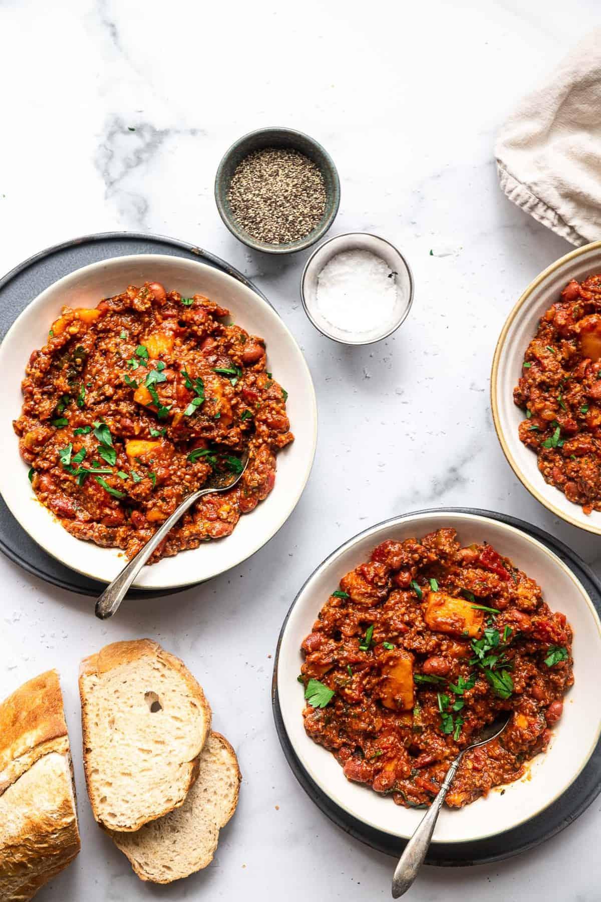 2 bowls of turkey sweet potato chili with crusty bread