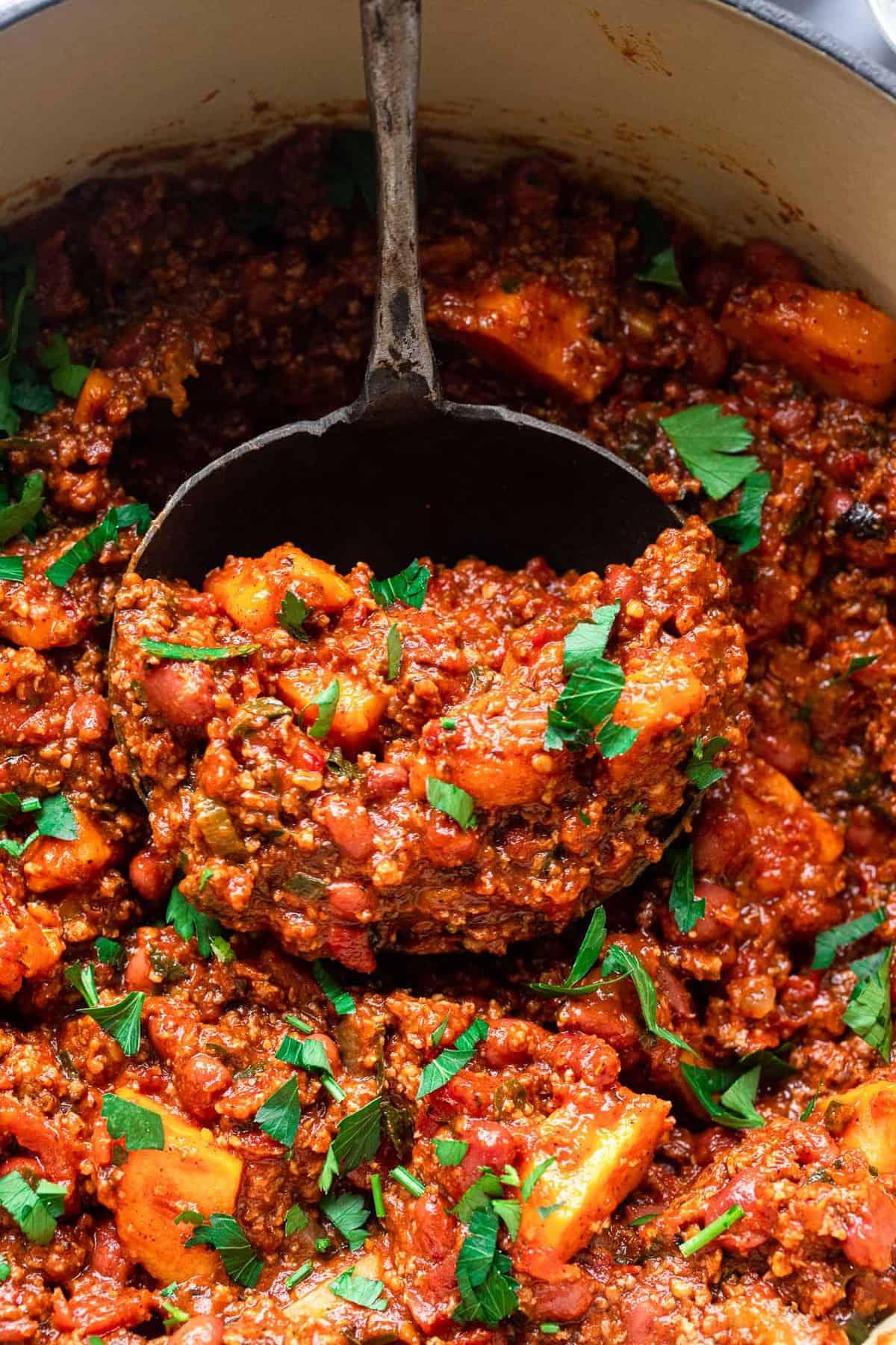 a lade full of turkey and sweet potato chili