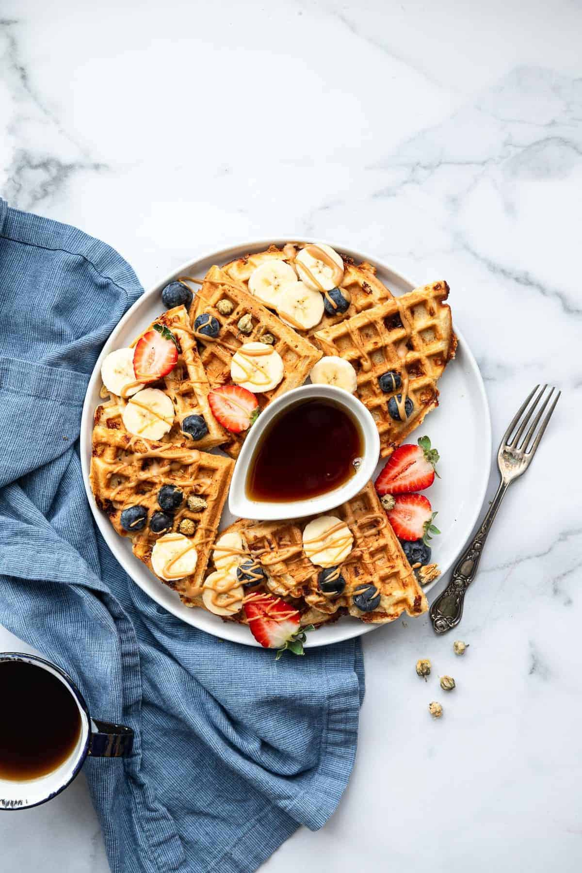 protein waffles on a plate with fruit on top