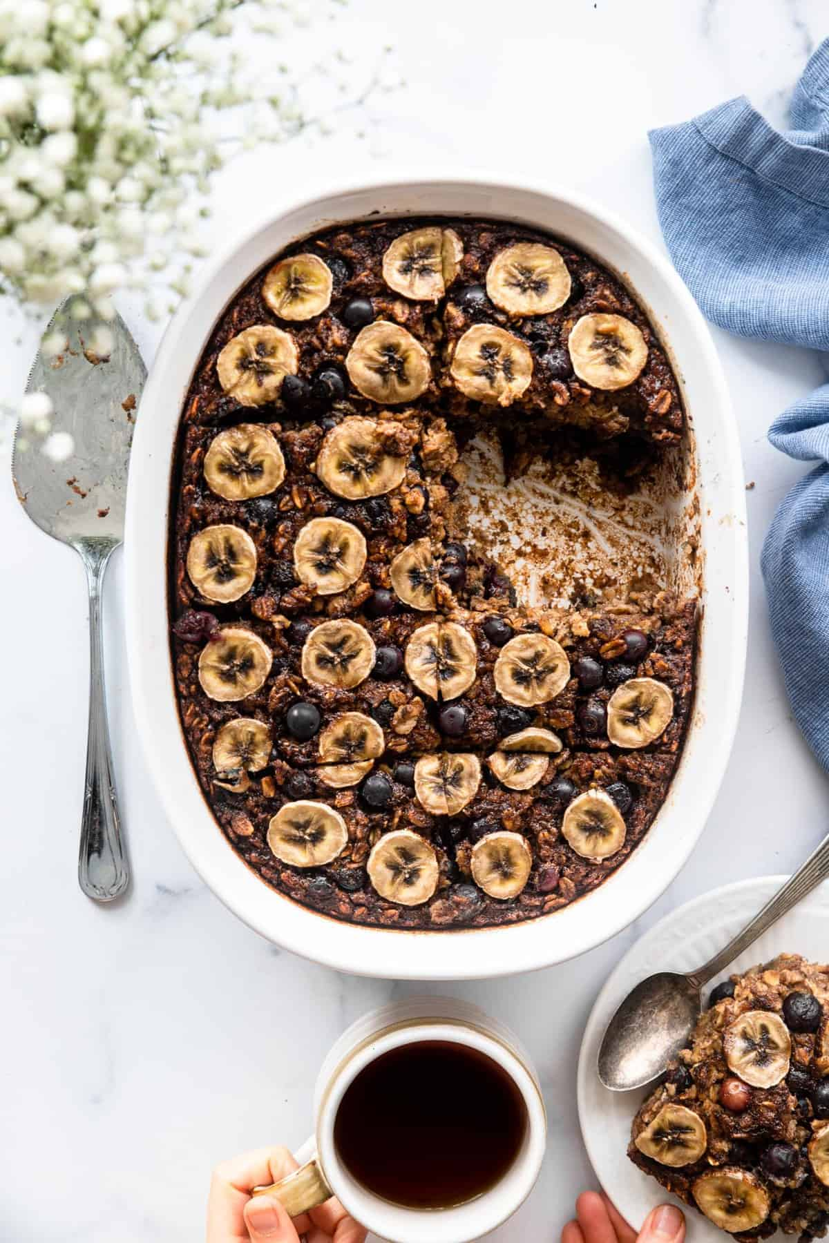 Blueberry baked oatmeal recipe ready to be eaten with a spoon on a table