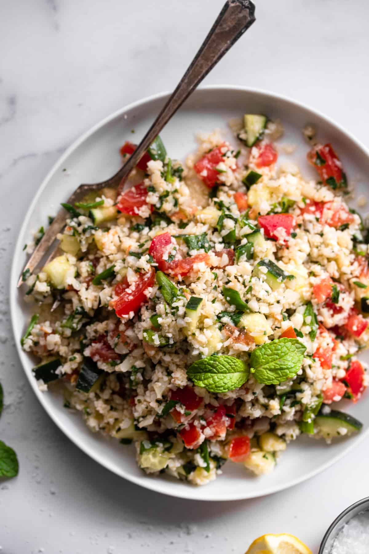 Tabbouleh Cauliflower in a serving plate with a spoon