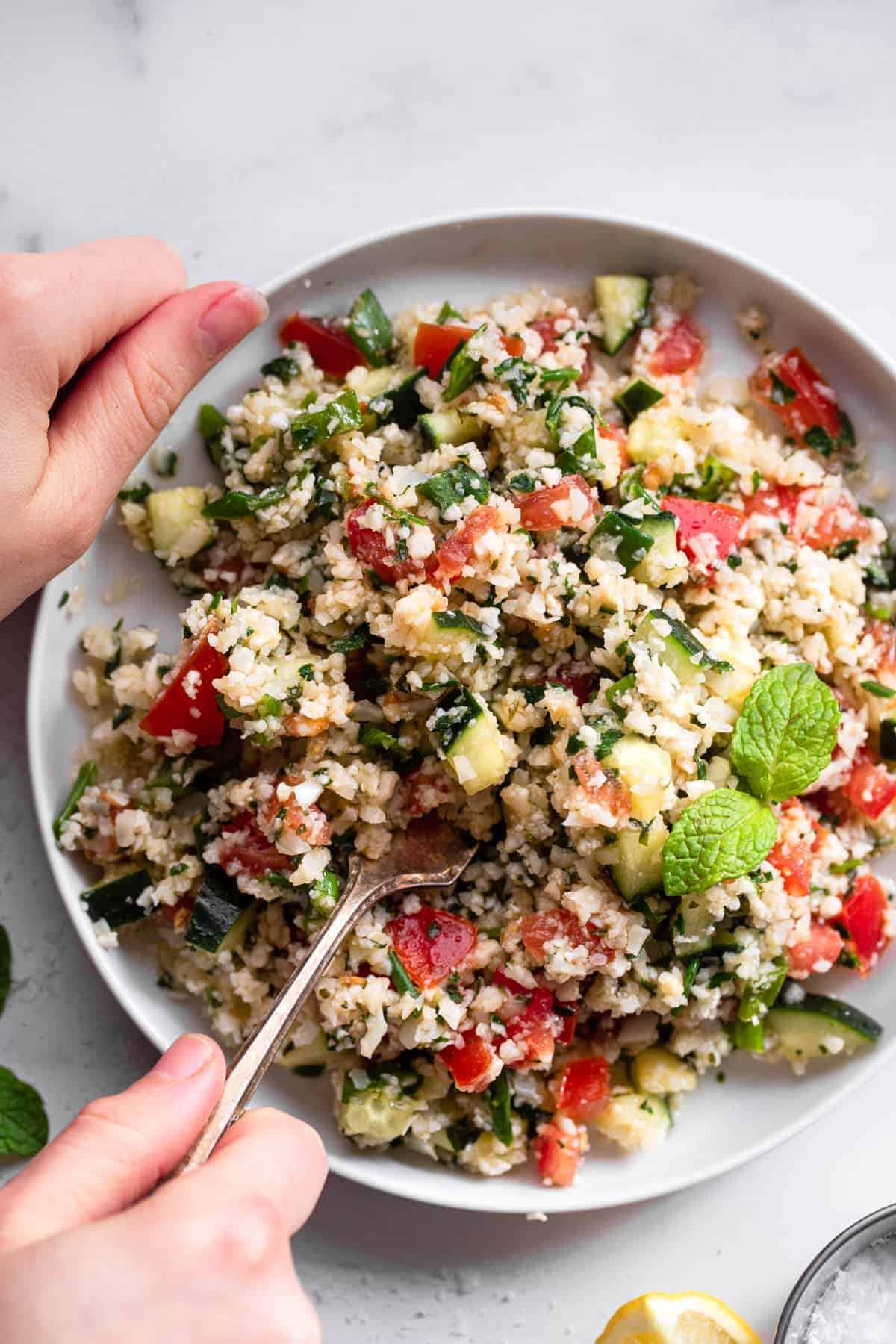 close up of Paleo Cauliflower Tabbouleh on a serving plate