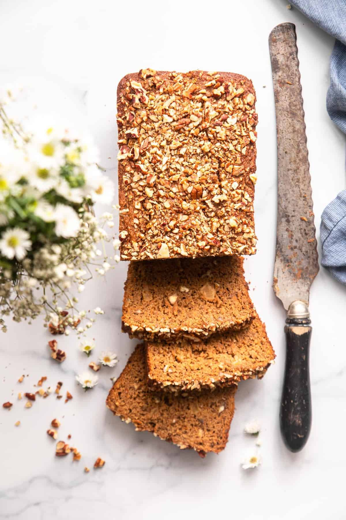 Healthy Carrot Bread sliced with bread knife on table