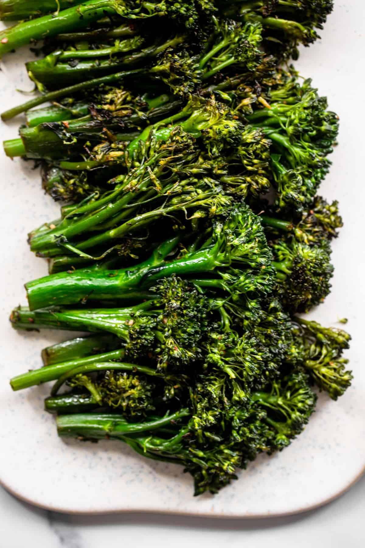 Sautéed broccoli close up on a board