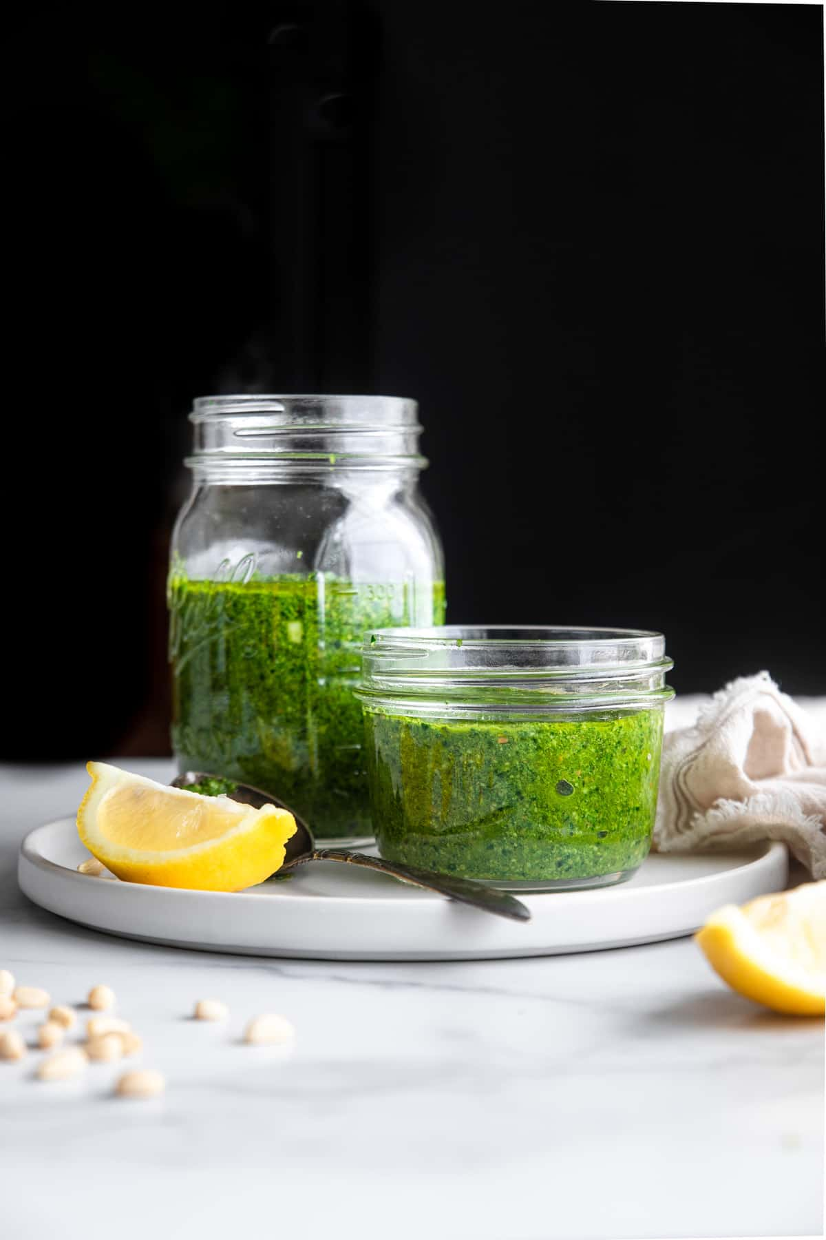 spinach pesto on a serving plate with lemon