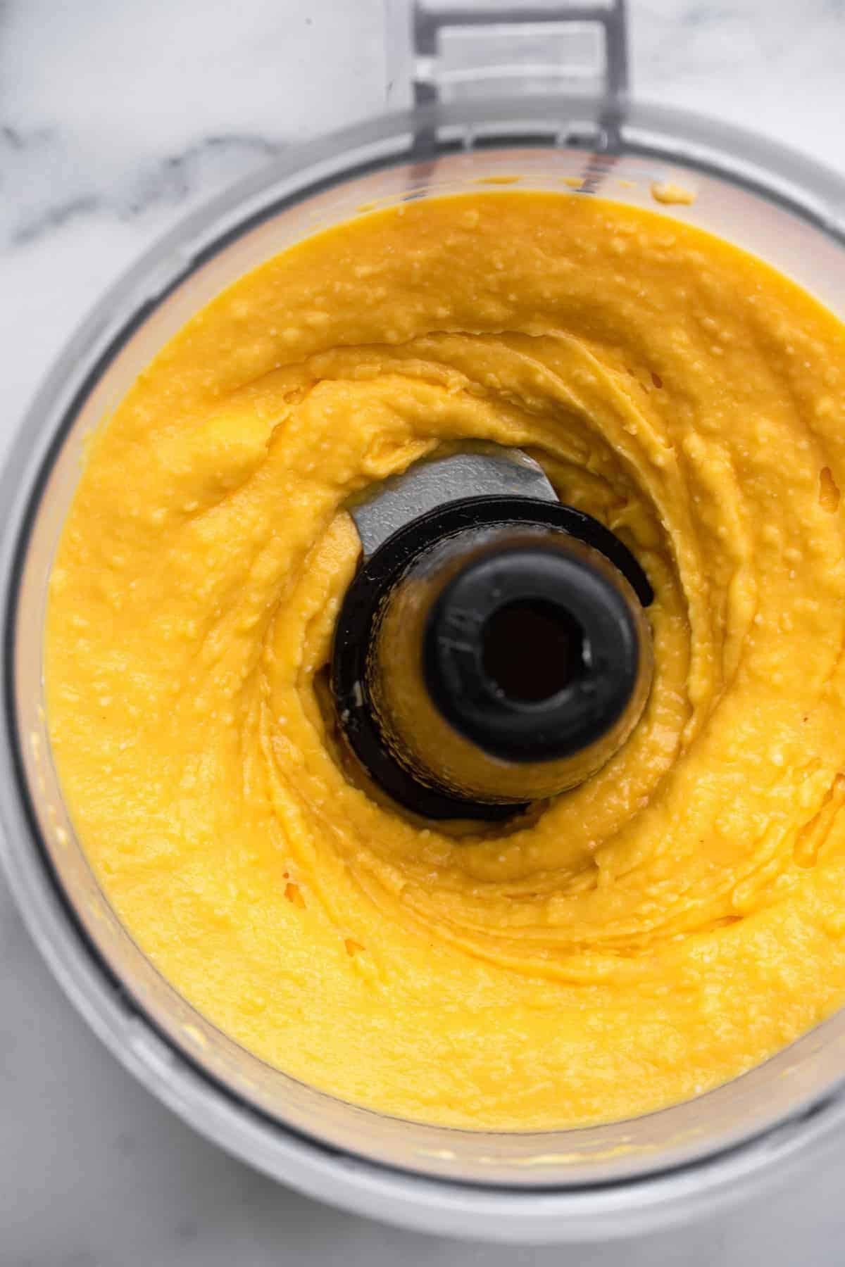 Mango yoghurt ice cream in a food processor