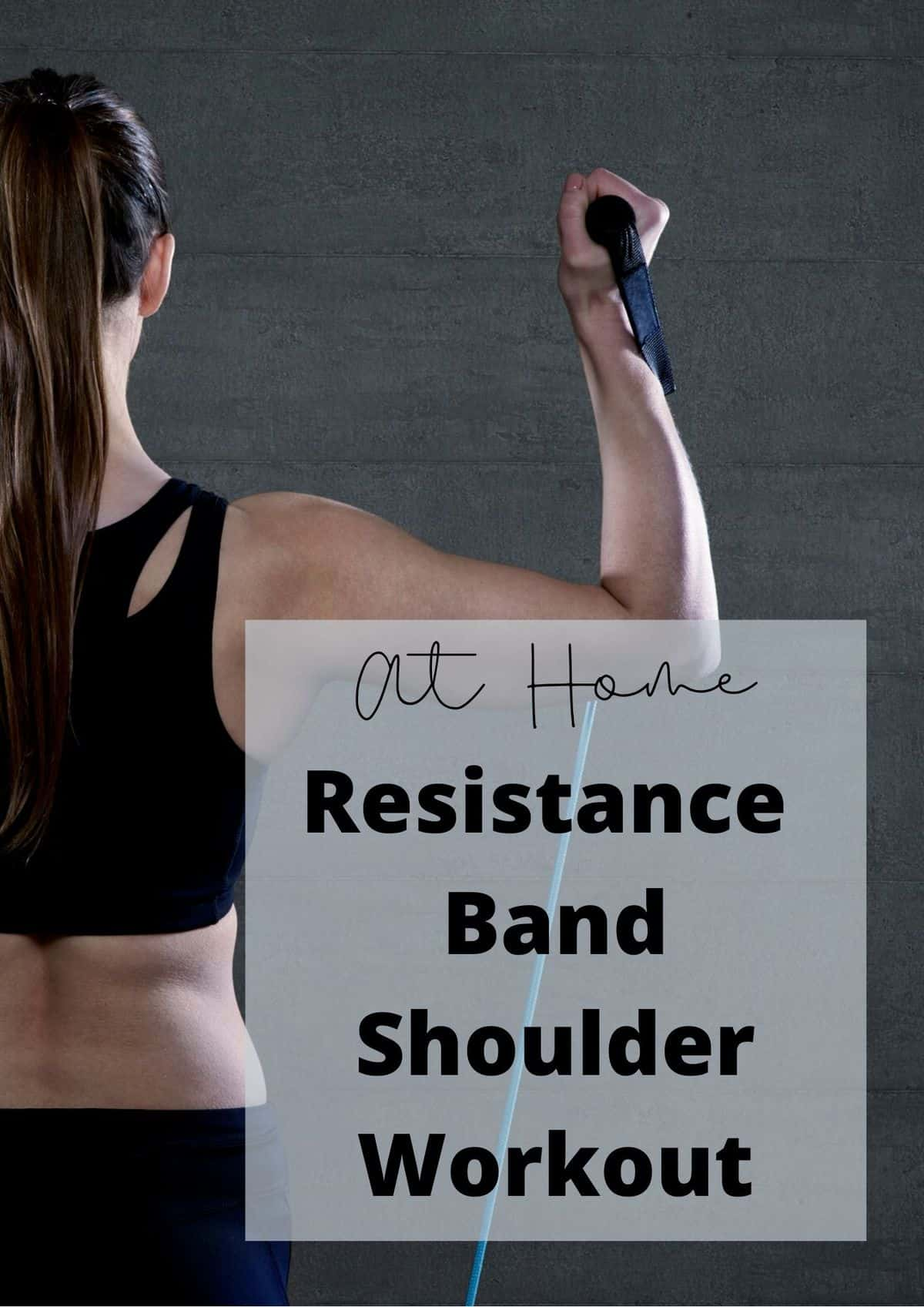 a woman holding a resistance band and working out her shoulder