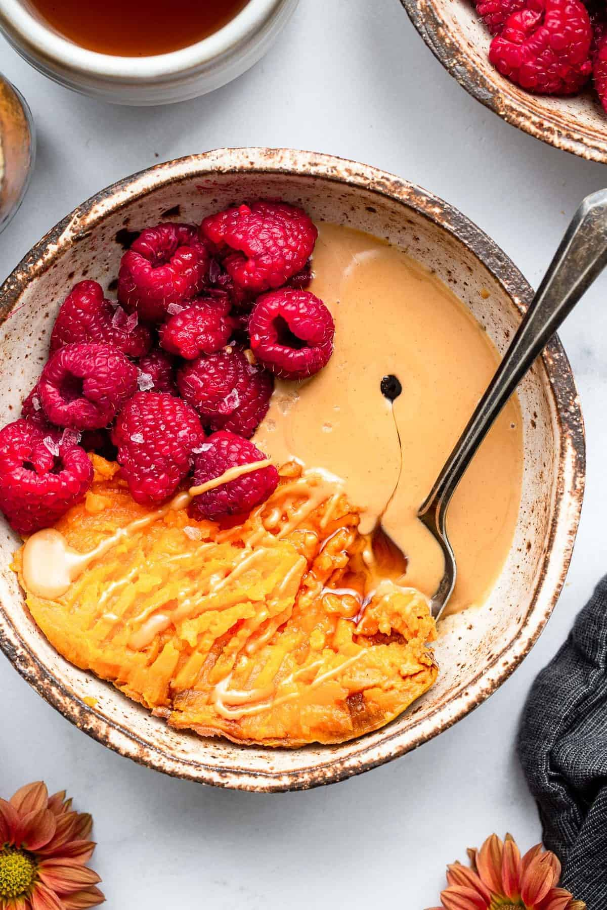 top up close view of sweet potato breakfast bowl with raspberries