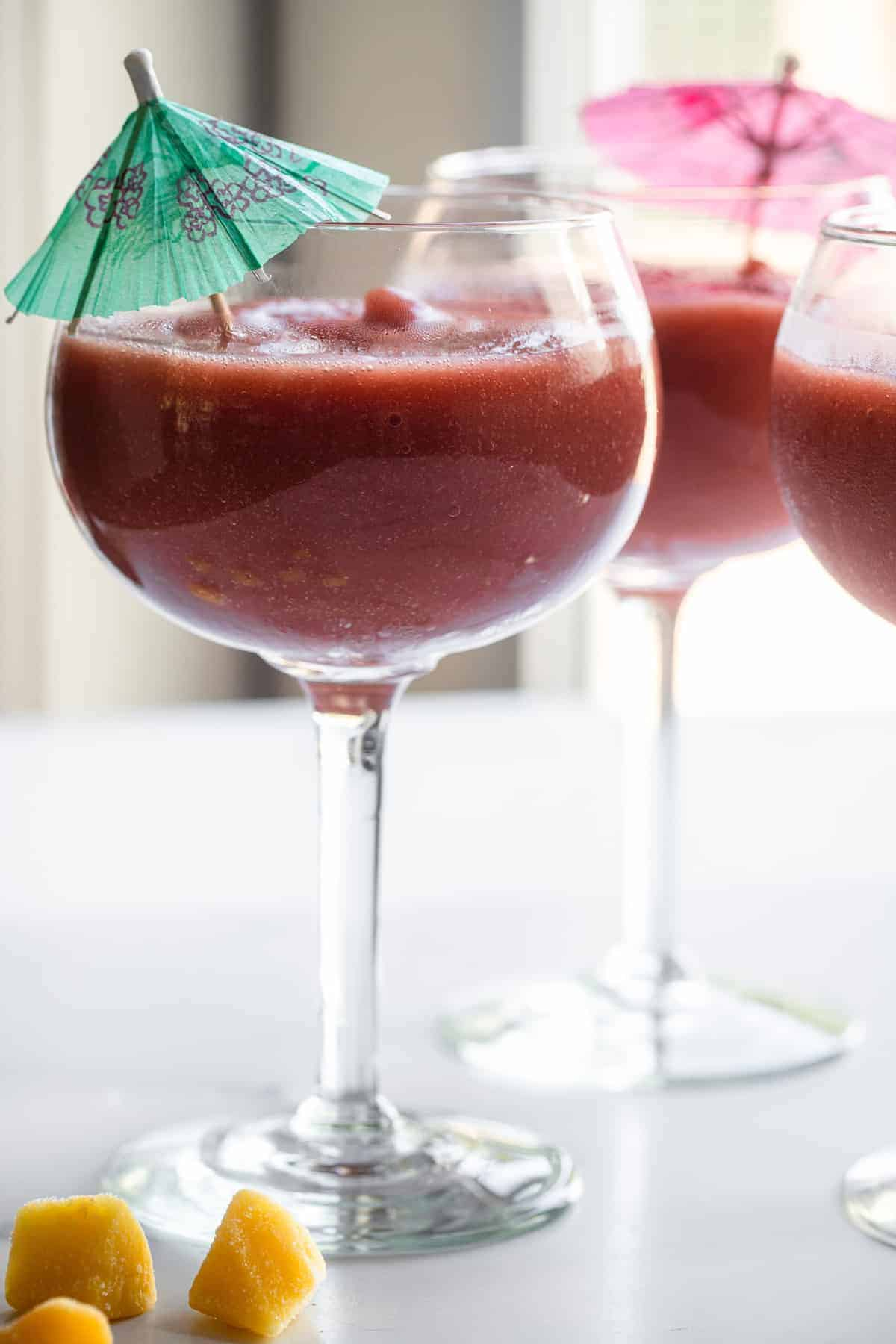 frozen sangria recipe in a wine glass with drink umbrella inside