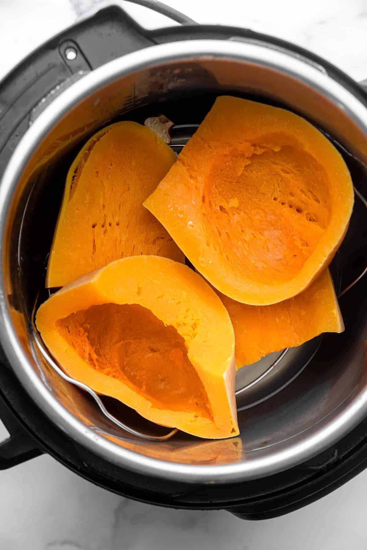 Instant Pot Butternut Squash in a pot ready to be cooked