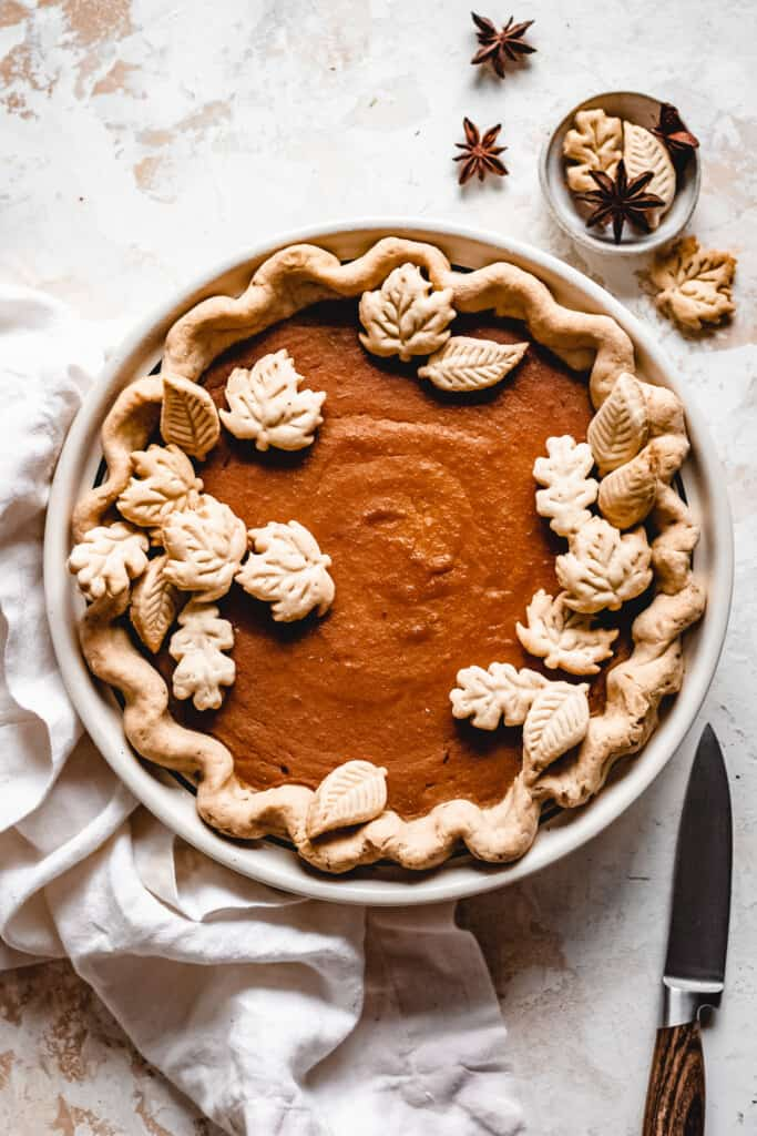 top vie of Creamy Vegan Butternut Squash Pie with decorations on it