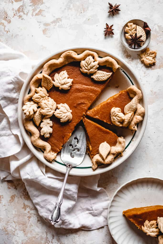Creamy Vegan Butternut Squash Pie cut up with a serving knife