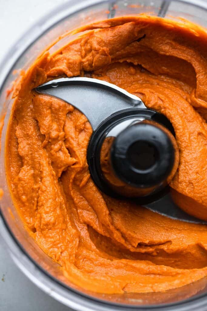 curry sweet potato almond butter dip being prepared in a food processor