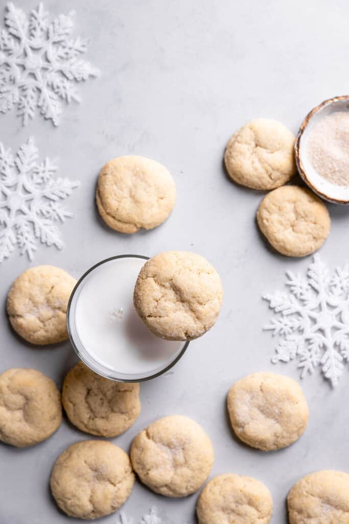 Eggless Sugar Cookies on a table with a glass of milk