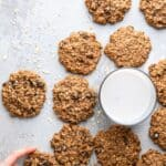 a bunch of Healthy Oatmeal Cookies around a glass of milk