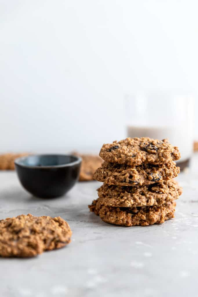 stack of Healthy Oatmeal Cookies with milk in the background