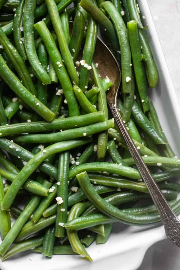 Instant Pot Green Beans ready to be served with a spoon