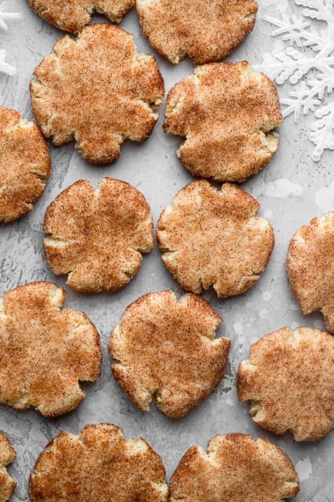 Keto Snickerdoodles on a baking sheet with parchment paper