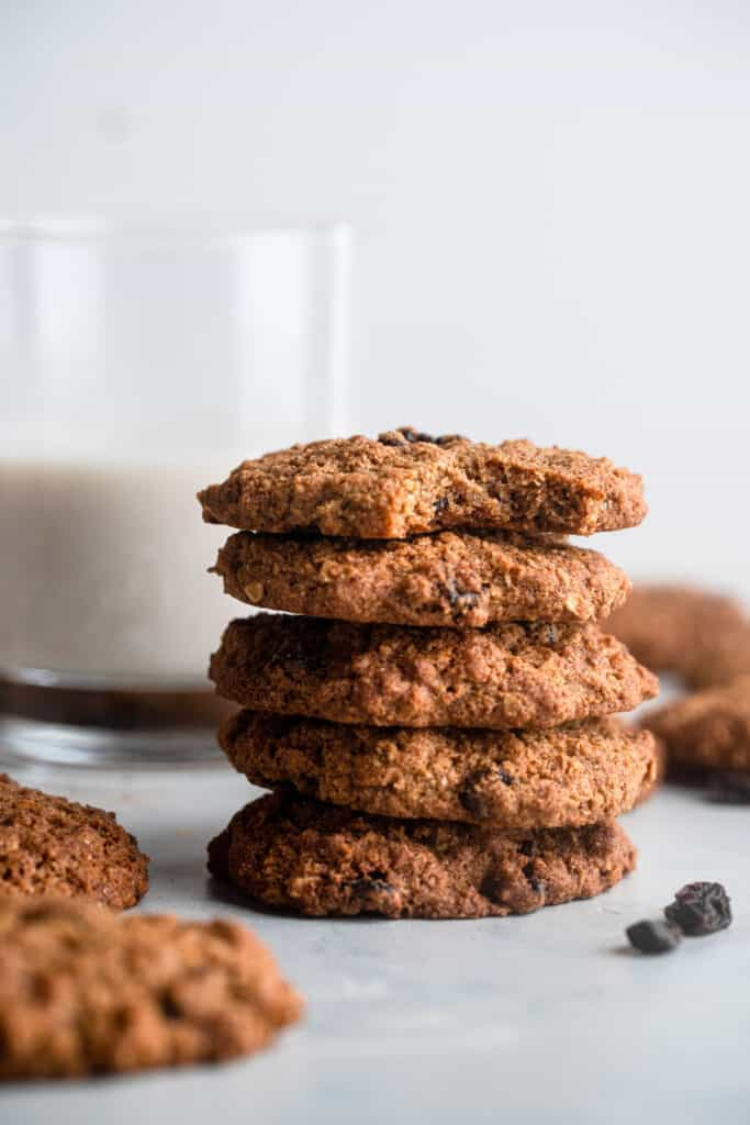 a stack of 5 Almond Flour Oatmeal Cookies with milk on the side