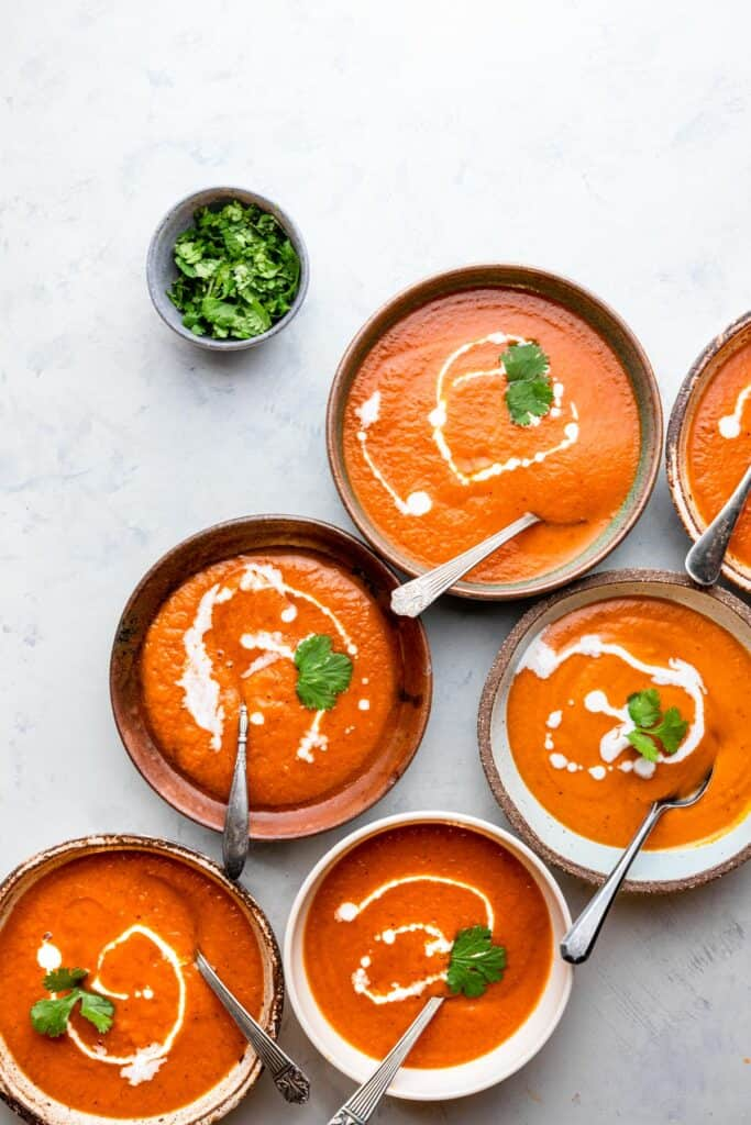Instant Pot Southwestern Sweet Potato Soup in bowls with cilantro on the side