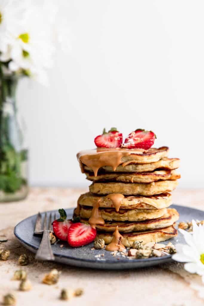 Whole30 Banana Pancakes with strawberries and drizzle on top