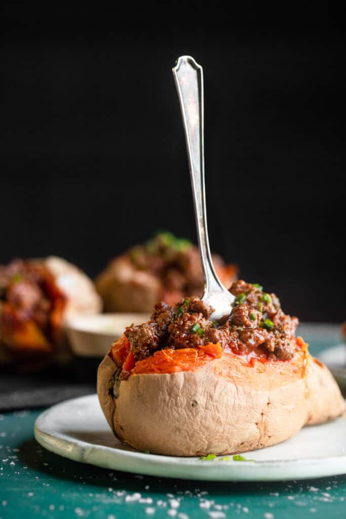 one Whole30 Sloppy Joe in a sweet potato with a fork