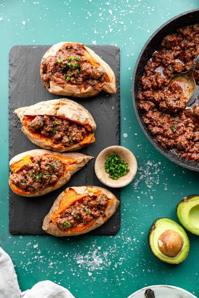Whole30 Sloppy Joes on a plate with avocado on the side
