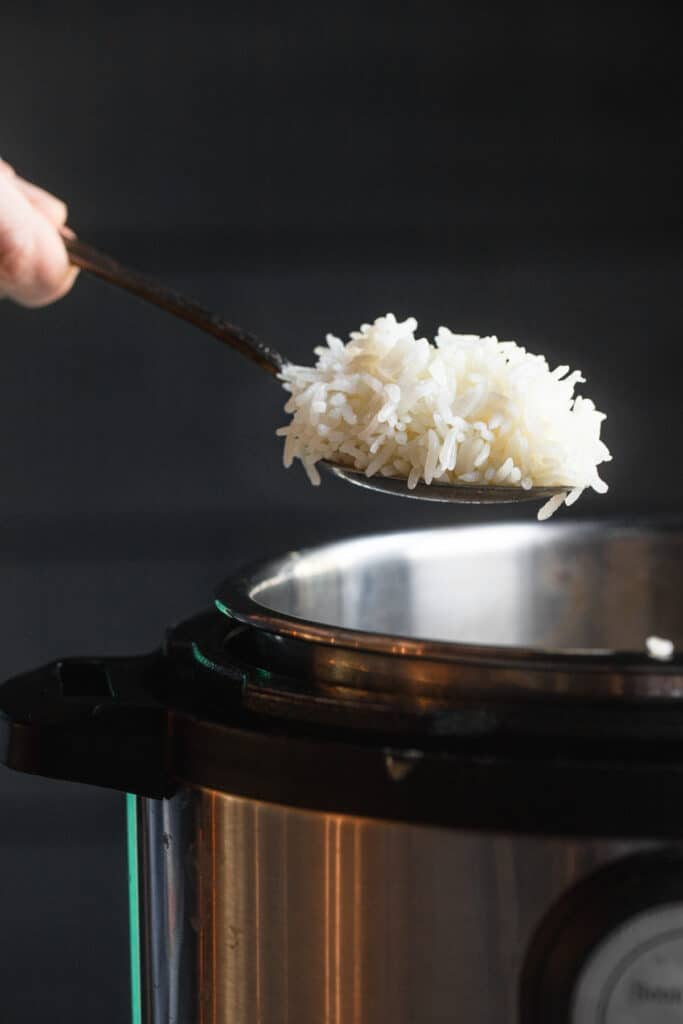 Instant Pot Coconut Rice being scooped out of the instant pot