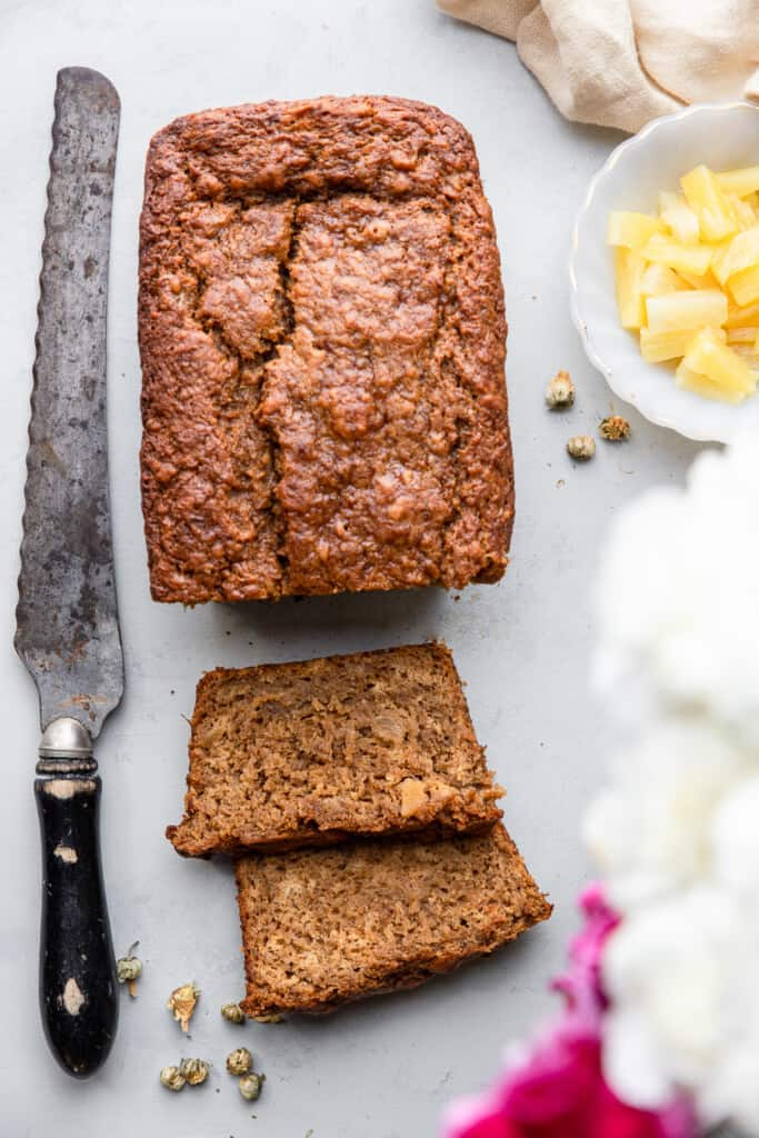 one loaf of Banana Pineapple Bread with a knife on the side