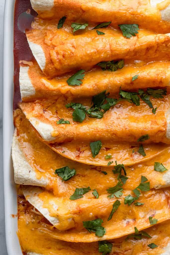 Instant Pot Chicken Enchiladas in a baking dish