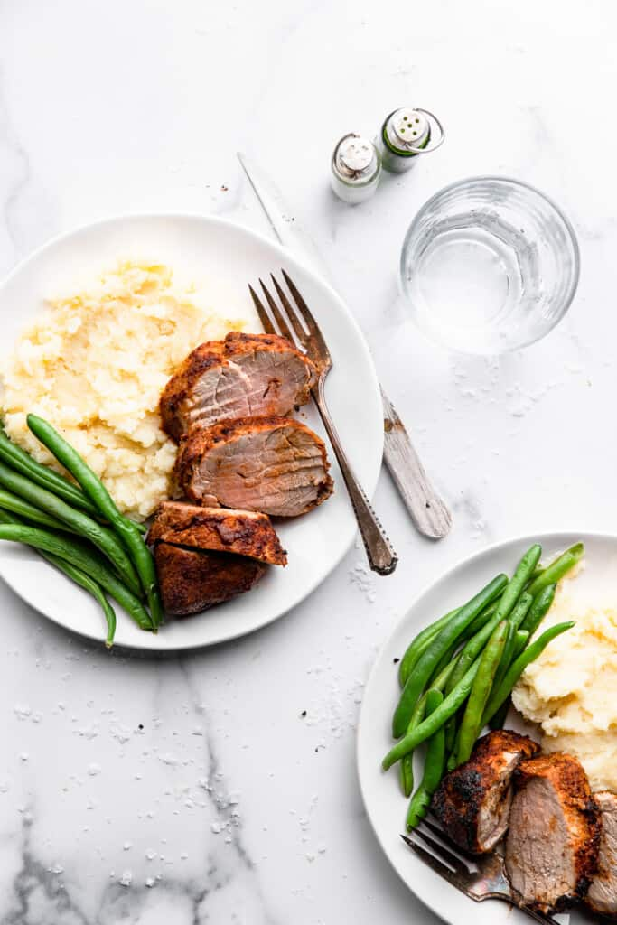 a dinner plate with Air Fryer Pork Tenderloin and side dishes