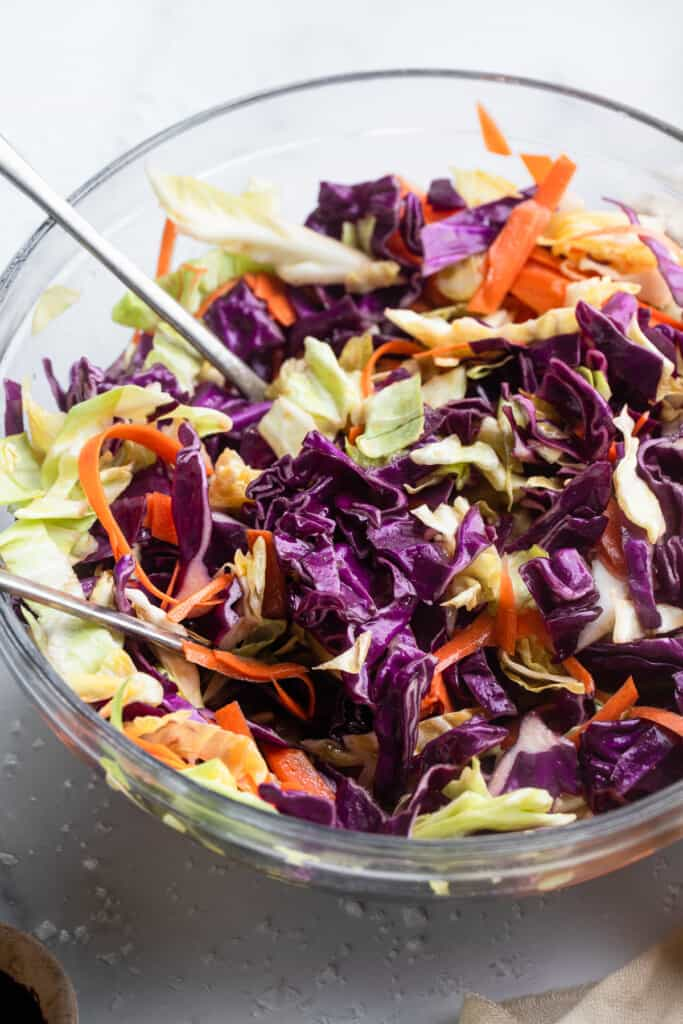 Cabbage Salad in a mixing bowl with spoon