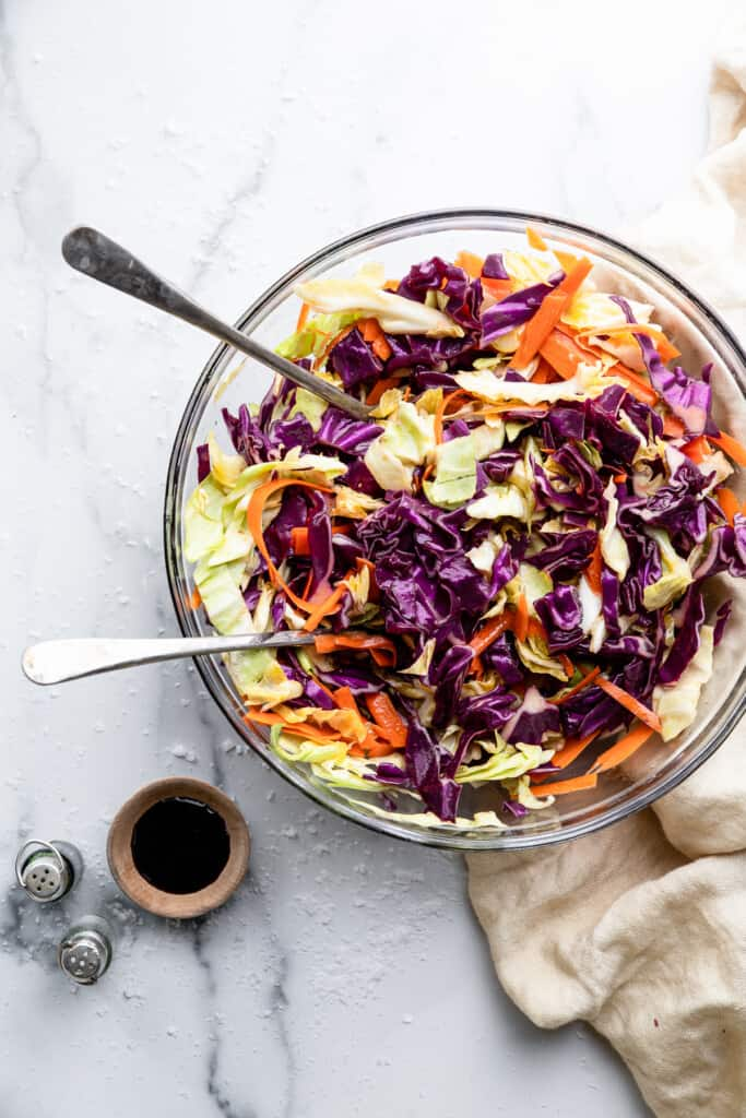 Cabbage Salad in a large bowl with serving forks