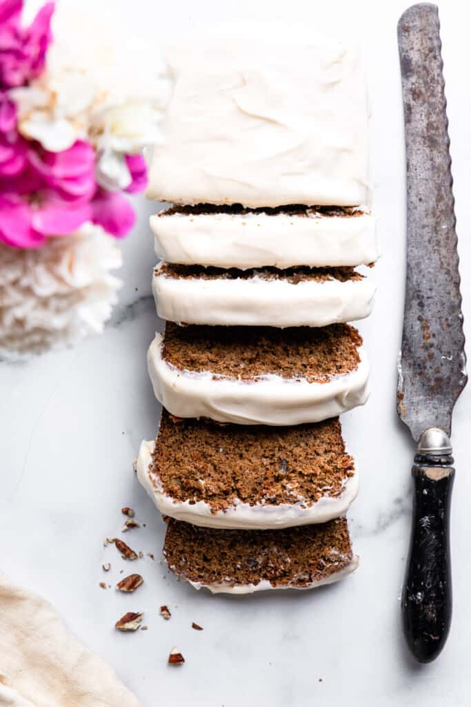 a loaf of Carrot Cake Bread with a bread knife on the side