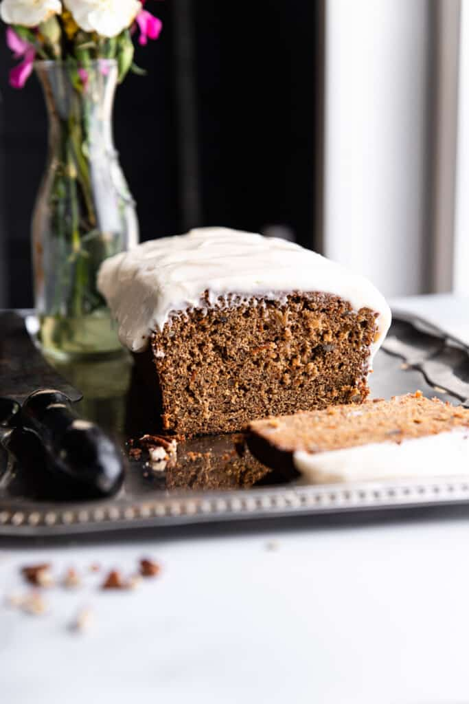 a loaf of Carrot Cake Bread on a serving plate