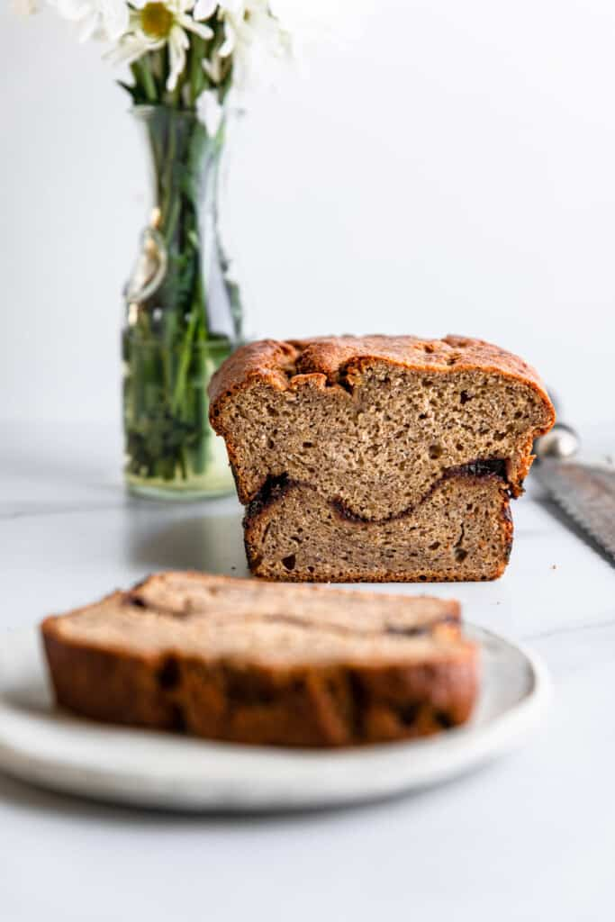 a slice of Cinnamon Banana Bread cut from the loaf an on a plate