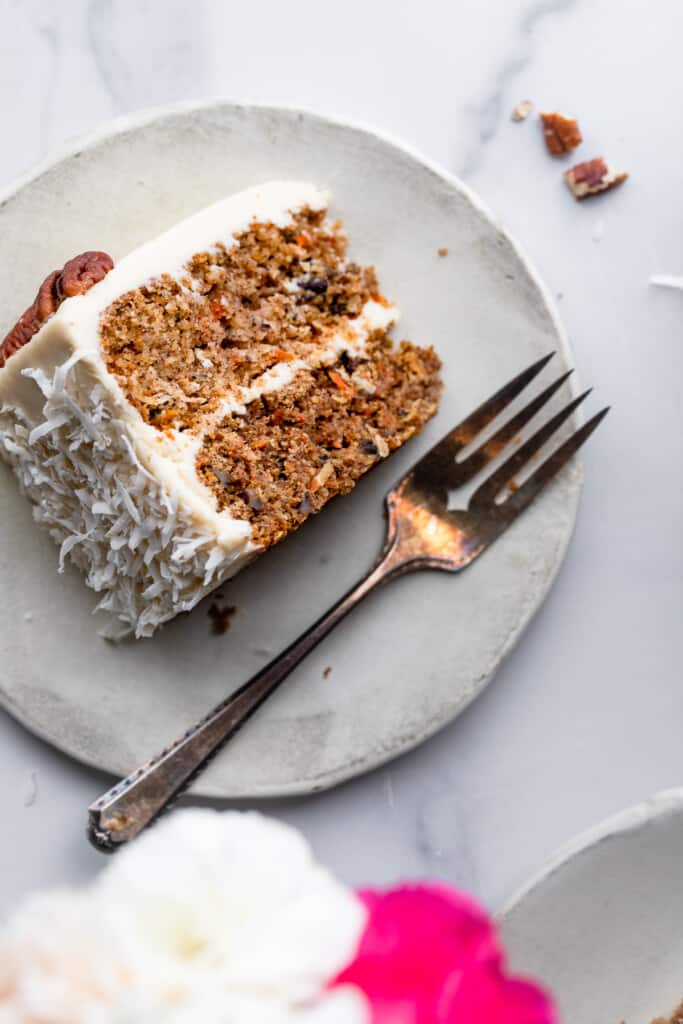 one slice of Low Carb Keto Carrot Cake on a small plate with a fork