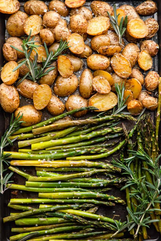 Roasted Potatoes and Asparagus arranged on a baking sheet