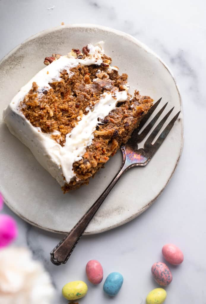 a slice of Vegan Carrot Cake with a fork