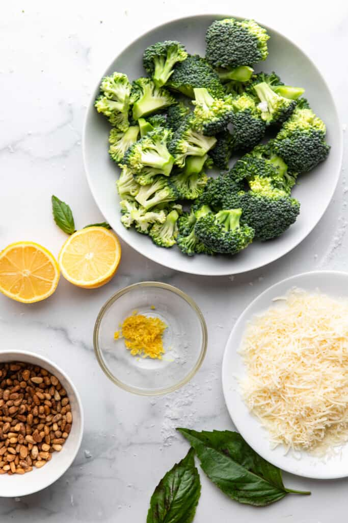 bowls full of ingredients for Broccoli Pesto