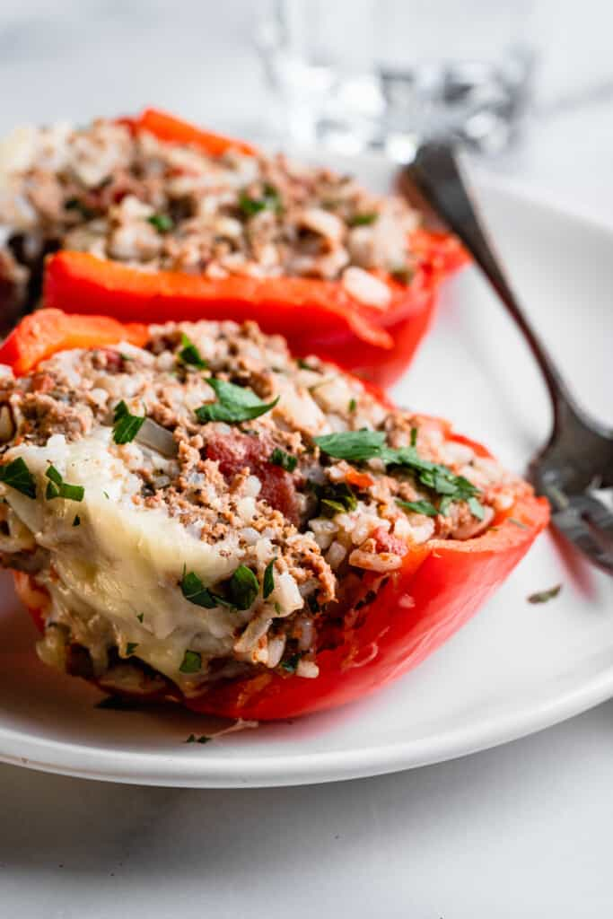 one Instant Pot Stuffed Peppers on a plate with a fork
