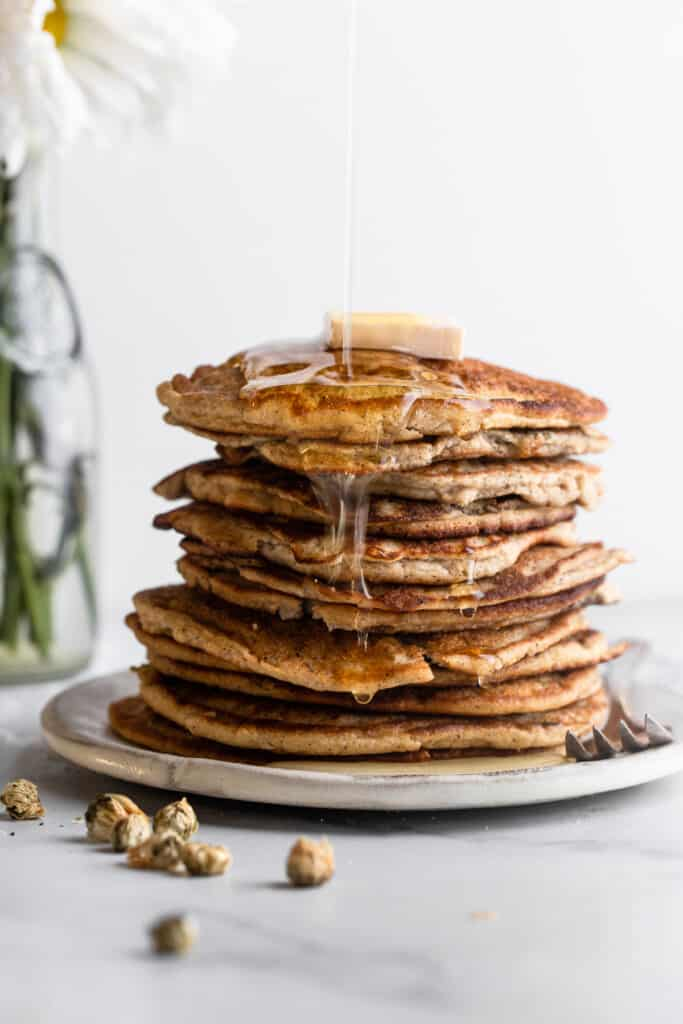 a stack of Keto Coconut Flour Pancakes with butter and syrup on top