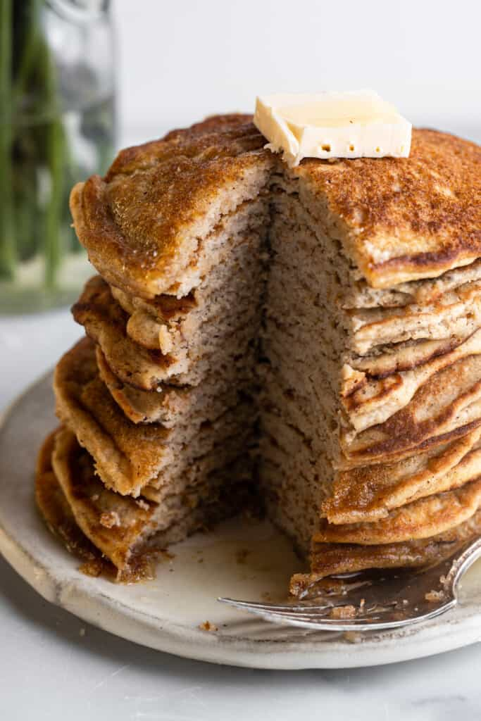 a large stack of Keto Coconut Flour Pancakes on a plate