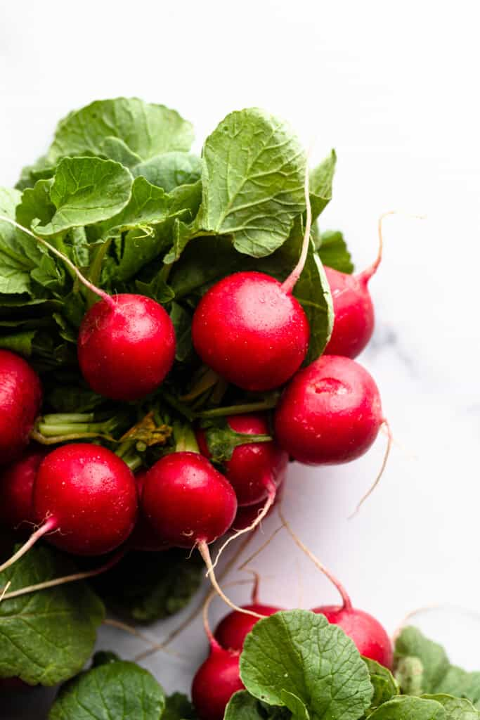 a bowl full of fresh radishes for Roasted Radishes