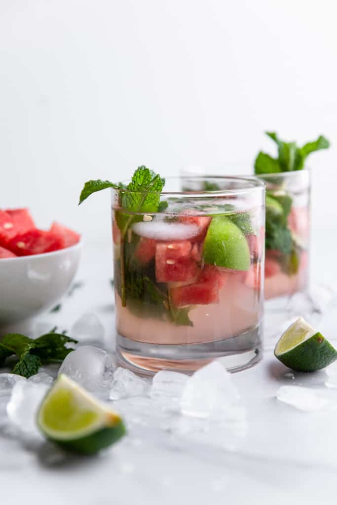 two cups of Watermelon Mojitos on a table