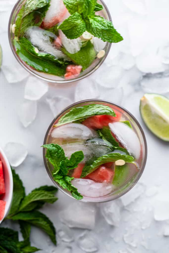 top view of Watermelon Mojitos on a table with lime on the side