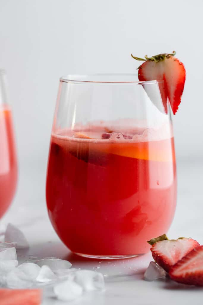a steamless wine glass filled with Watermelon Sangria