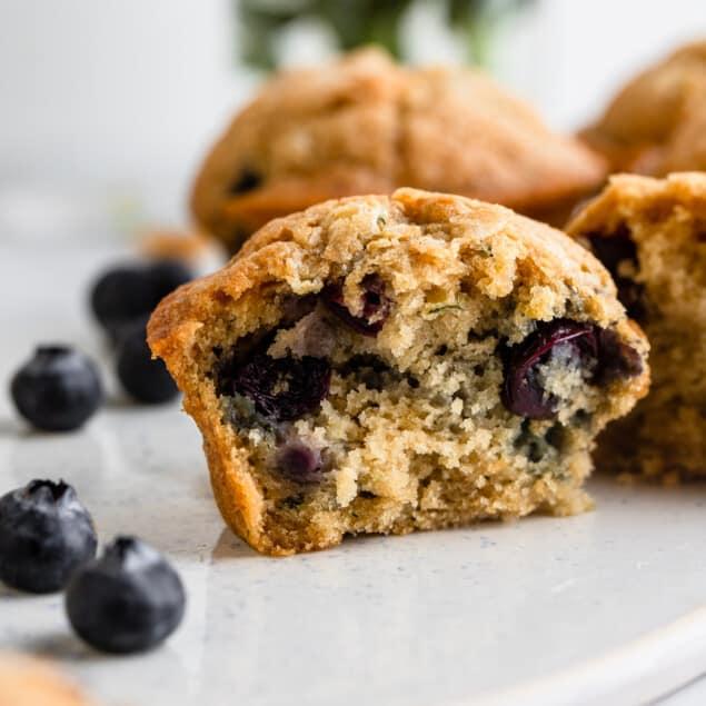 one Zucchini Blueberry Muffins cut in half